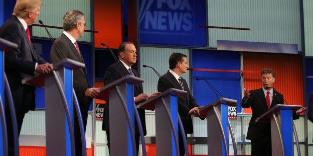 Republican presidential candidates from left, Donald Trump, Jeb Bush, Mike Huckabee, Ted Cruz and Rand Paul take the stage fo