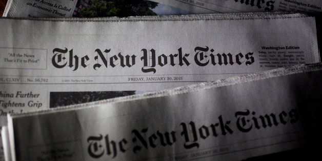 New York Times newspapers are arranged for a photograph in Washington, D.C., U.S., on Friday, Jan. 30, 2015. The New York Tim