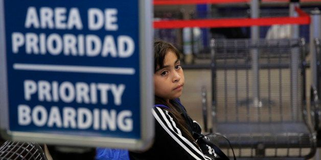 An immigrant from Guatemala who entered the country illegally waits at a bus station she and others were released from a fami