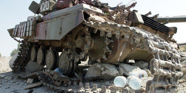 A picture taken on September 6, 2014 outskirts the key southeastern port city of Mariupol shows a destroyed tank the day afte