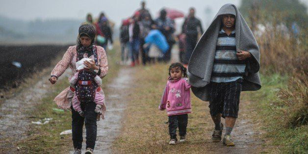 ROSZKE, HUNGARY- SEPTEMBER 10: Refugees arrive at a makeshift camp for asylum seekers near the border line between Serbia and