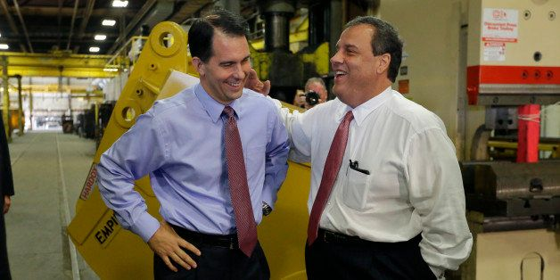 New Jersey Gov. Chris Christie, right, and Wisconsin Gov. Scott Walker share a laugh as Walker campaigns at Empire Bucket in