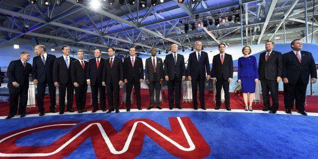 Republican presidential hopefuls, (L-R) South Carolina Sen. Lindsay Graham, former New York Gov. George Pataki, Sen. Rick San