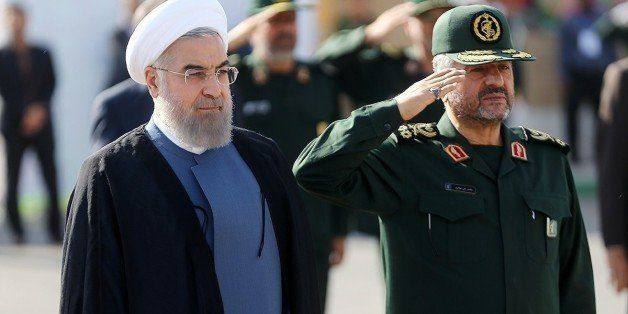 TEHRAN, IRAN - SEPTEMBER 15:  Iranian President Hassan Rouhani (L) and IRGC Major General Mohammad Ali Jafari (R) attend the
