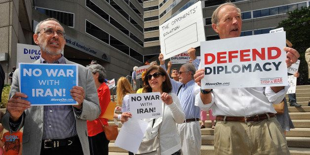 BALTIMORE, MD - AUGUST 26:  MoveOn members and anti-war activists demonstrate outside the office of Sen. Ben Cardin (D-Md.),