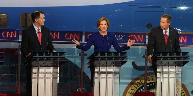 SIMI VALLEY, CA - SEPTEMBER 16:  Republican presidential candidates, Wisconsin Gov. Scott Walker, Carly Fiorina and Ohio Gov.