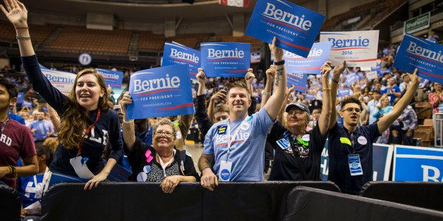 MANCHESTER, NH - SEPTEMBER 19:  Supporters of democratic presidential candidate Senator Bernie Sanders (I-VT) hold up signs w