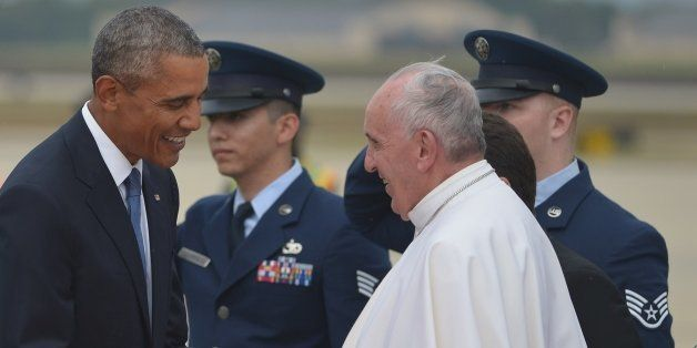 US President Barack Obama (L) greets Pope Francis (R) upon his arrival  September 22, 2015 at Andrews Air Force Base in Maryl