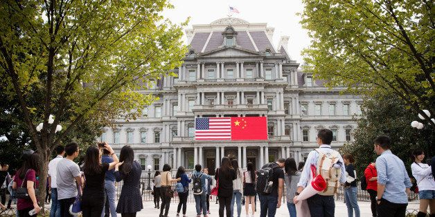 In this Thursday, Sept. 24, 2015, photo, China's flag is displayed next to the American flag on the side of the Old Executive