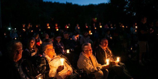WINSTON, ORE. -- SATURDAY, OCTOBER 3, 2015: Community members hold a candlelight vigil during a memorial service called 'Pray