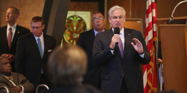 FERGUSON, MO - AUGUST 14:  Missouri Governor Jay Nixon speaks about the unrest in the town of Ferguson following the shooting