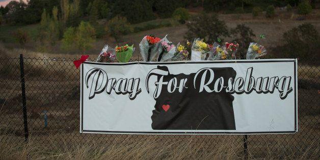 ROSEBURG, OR - OCTOBER 02:  A sign sits along the road to Umpqua Community College on October 2, 2015 in Roseburg, Oregon.  Y