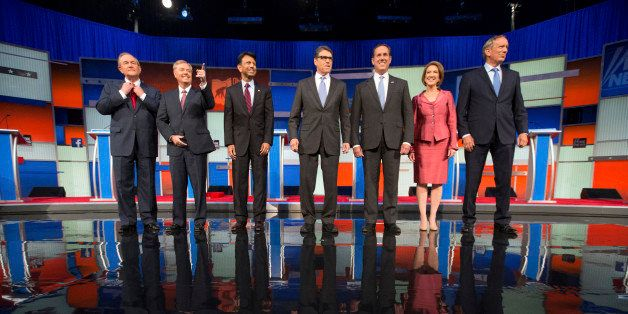 Republican presidential candidates from left, Jim Gilmore, Lindsey Graham, Bobby Jindal, Rick Perry, Rick Santorum, Carly Fio
