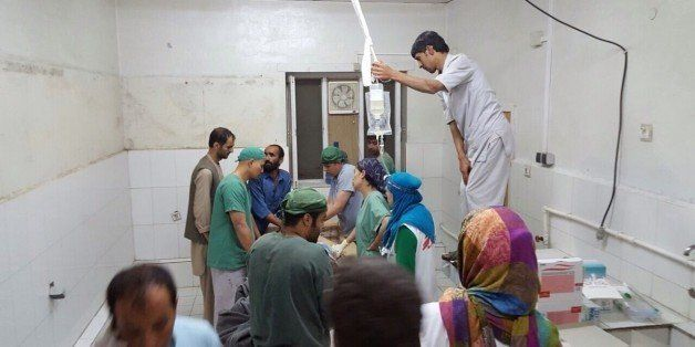KUNDUZ, AFGHANISTAN -OCTOBER 03: Doctors Without Borders (MSF) staff are seen during a surgery after a US airstrike on MSF ho