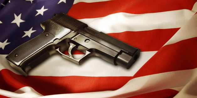 Handgun lying on American flag
