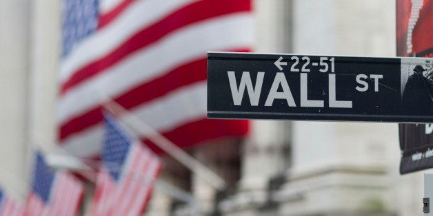In this Aug. 8. 2011 photo, a Wall Street sign hangs near the New York Stock Exchange, in New York. Stocks tanked again Tuesd