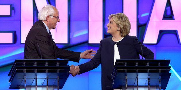 LAS VEGAS, NV - OCTOBER 13:  Democratic presidential candidates U.S. Sen. Bernie Sanders (I-VT) (L) and Hillary Clinton shake