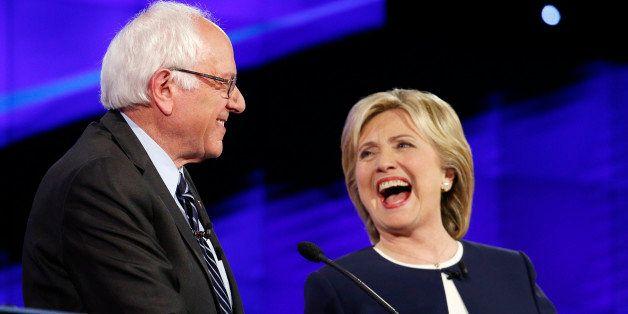 Sen. Bernie Sanders, of Vermont,, left, and Hillary Rodham Clinton laugh during the CNN Democratic presidential debate, Tuesd