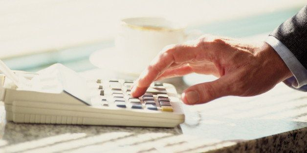 Man's hand using calculator