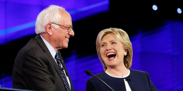 Sen. Bernie Sanders, of Vermont, left, and Hillary Rodham Clinton laugh during the CNN Democratic presidential debate Tuesday