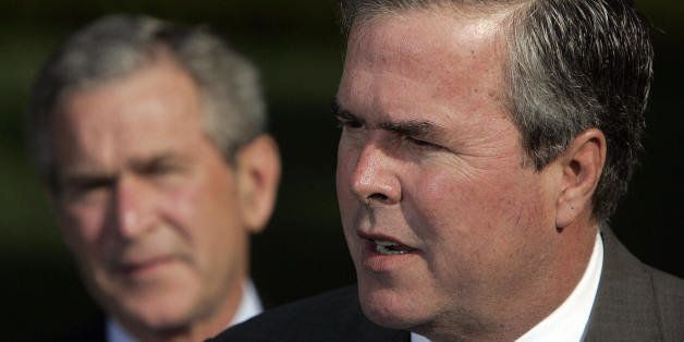 Washington, UNITED STATES:  US President George W. Bush (L) looks on as his brother Florida Governor Jeb Bush speaks 19 April