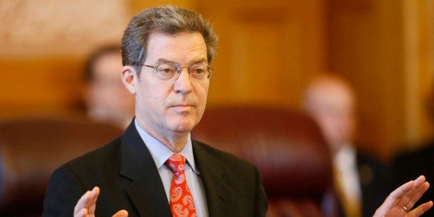 Kansas Gov. Sam Brownback addresses a joint caucus of the state Senate and House Republicans on Thursday, June 11, 2015, stre