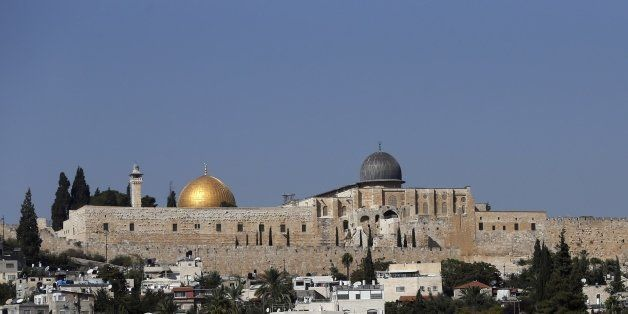 A picture taken on October 15, 2015 shows the Dome of the Rock mosque (golden dome) and al-Aqsa Mosque (silver dome) at the a