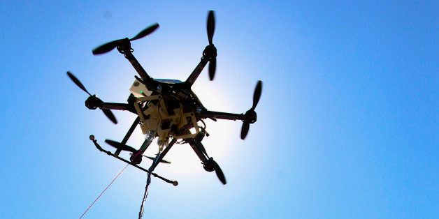 A water collecting drone with it's three containers and collection tube is silhouetted by the sun at a testing site in Lincol