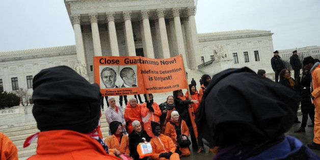 WASHINGTON, DC - JANUARY 11:  Members of the organization Witness Against Torture, some of them wearing orange prison jump su
