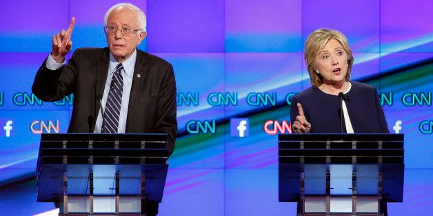Hillary Rodham Clinton, right, and Sen. Bernie Sanders, of Vermont, speak during the CNN Democratic presidential debate Tuesd