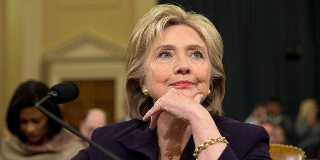 Democratic presidential candidate and former Secretary of State Hillary Rodham Clinton, listens as she testifies on Capitol H