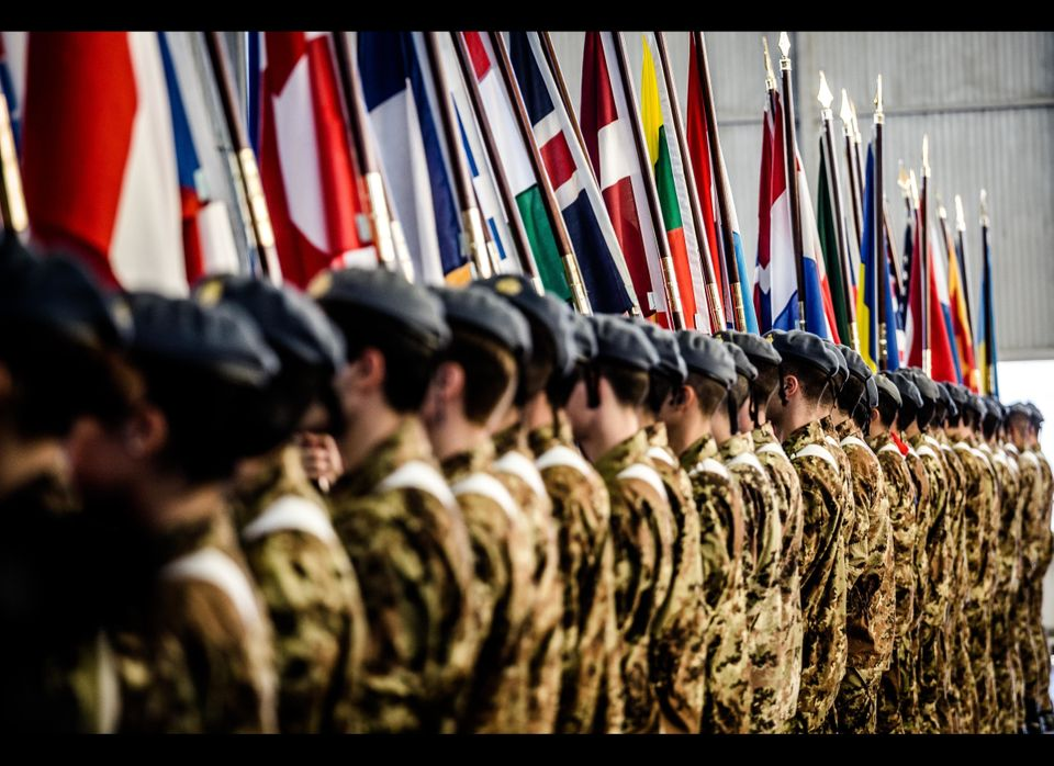 Trident Juncture 2015 continues its opening ceremony in Trapani, Italy, with a parade of flags of all participating nations.