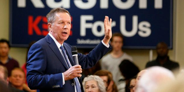 Republican presidential candidate, Ohio Gov. John Kasich gestures during a town hall meeting at the University of Richmond in