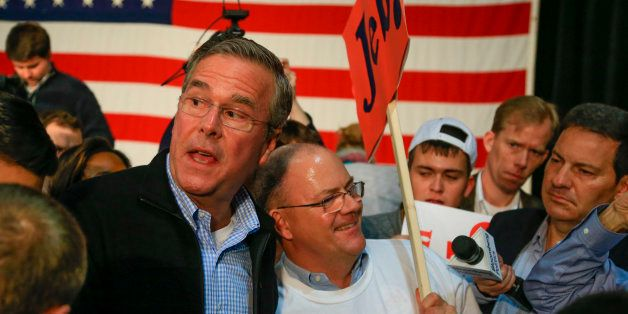 Republican presidential candidate, former Florida Gov. Jeb Bush mingles with supporters after speaking at the Iowa GOP's Grow