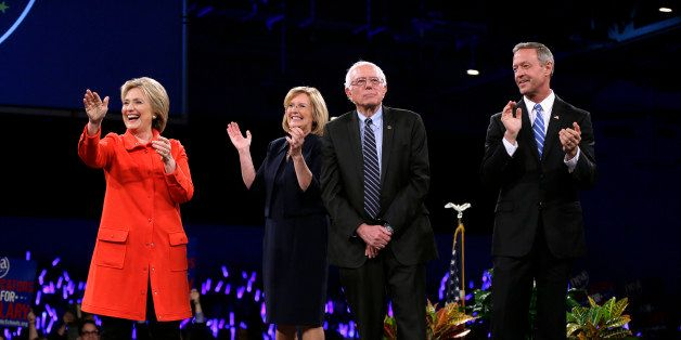 Democratic presidential candidates Hillary Rodham Clinton, left, Sen. Bernie Sanders, I-Vt., second from right, and former Ma