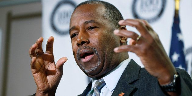 Republican presidential candidate Ben Carson gestures during a news conference during a campaign stop, Thursday, Oct. 29, 201
