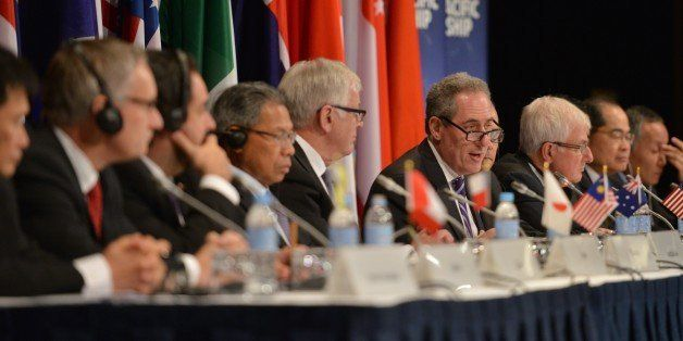 US Trade Representative Mike Froman (C) speaks at a press conference for the Trans-Pacific Partnership (TPP), a pan-Pacific t