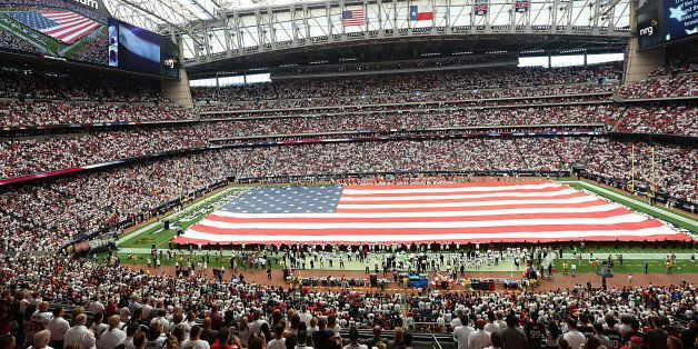 HOUSTON, TX - SEPTEMBER 13: A large American flag is stretched across the field for the National Anthem before the Houston Te