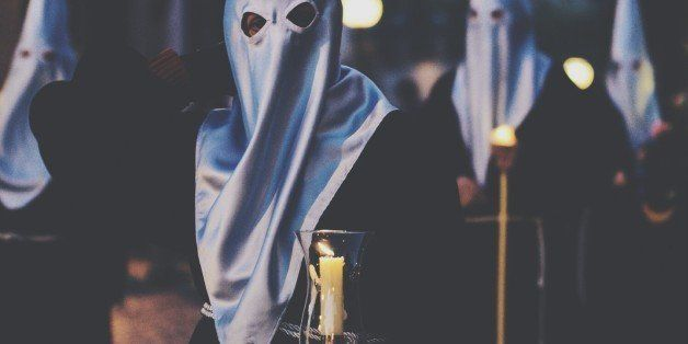 People Holding Lit Candle In Ku Klux Klan Rally