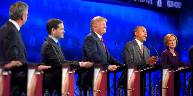 Ben Carson, second from right, speaks, as Jeb Bush, left, Marco Rubio, second from left, Donald Trump, center, and Carly Fior