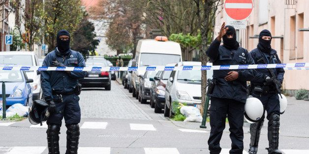 Armed police guard a street in Brussels on Monday, Nov. 16, 2015. A major action with heavily armed police is underway in the