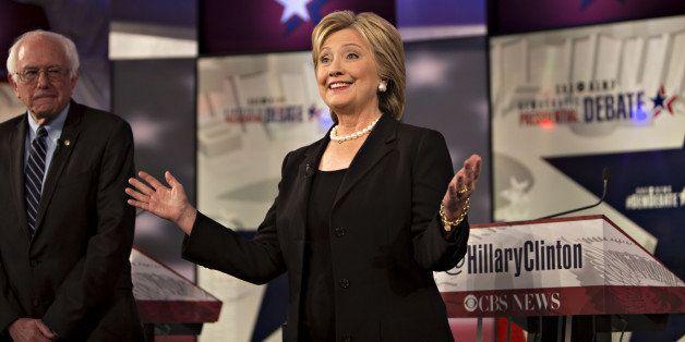 Democratic presidential candidates Hillary Clinton, former Secretary of State, right, gestures as Senator Bernie Sanders, an