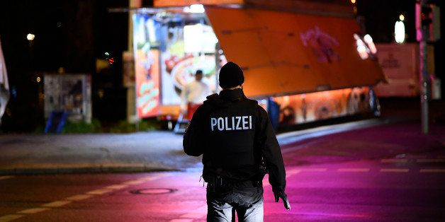HANOVER, GERMANY - NOVEMBER 17:  Police forces secure a scene at Robert-Enke-Strasse after finding a suspicious piece of lugg