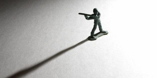 Toy soldier casting a long shadow.