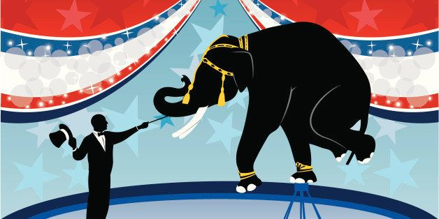 A ring master giving a show with an elephant at a circus.