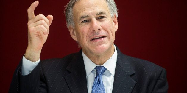 Greg Abbott, governor of Texas, speaks during an interview in New York, U.S., on Tuesday, July 14, 2015. Since Texas won a co