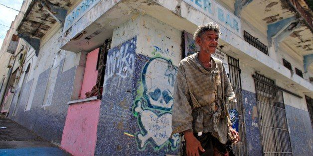 A homeless man stands in front of a closed down business in Puerta de Tierra in the outskirts of Old San Juan, Puerto Rico, S