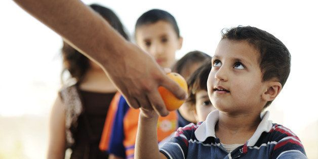 hungry children in refugee camp ...