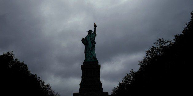 The Statue of Liberty stands tall as cloud hover over it in New York on October 3, 2015. AFP PHOTO/JEWEL SAMAD        (Photo