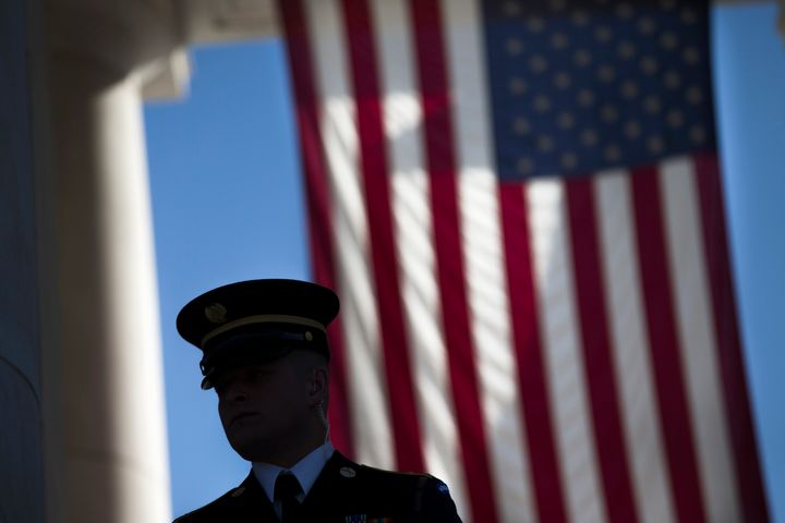 A member of the honor guard waits for the arrival of visitors to the annual Veterans Day Observance Ceremony at Arlington Nat